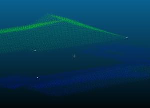 Figura 10. Esempio di validazione direttamente sulla nuvola di punti. I punti colorati sono il dato collezionato mentre quelli bianchi sono i punti di controllo. Si osservi la coincidenza degli spigoli.